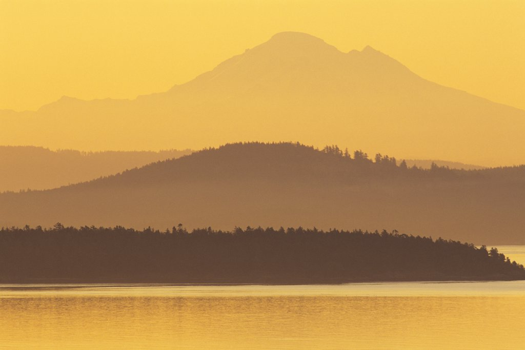 Stock Photo: 4097-945A Island with mountain peak in the background, San Juan Island, Mt Baker, Haro Strait, Saanich Peninsula, Vancouver Island, British Columbia, Canada
