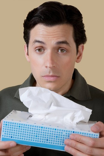 Stock Photo: 4105-1054 Man holding a tissue paper box