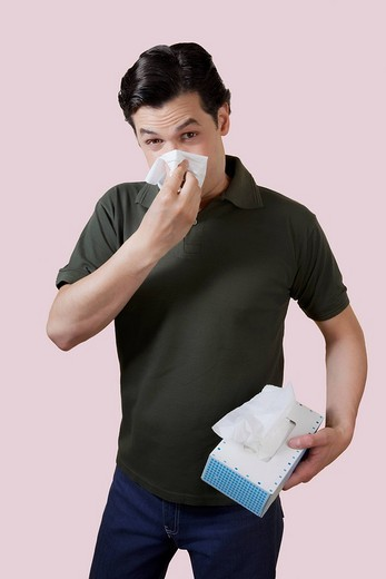 Stock Photo: 4105-1060 Man blowing his nose
