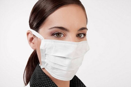 Stock Photo: 4105-1229 Female doctor wearing a flu mask