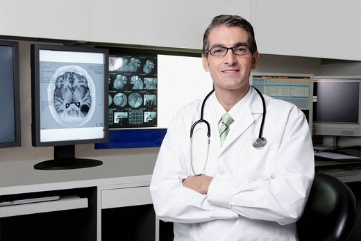 Portrait of a doctor with MRI report : Stock Photo
