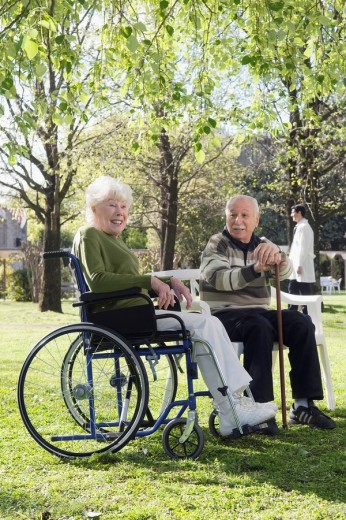 Couple sitting in a park : Stock Photo