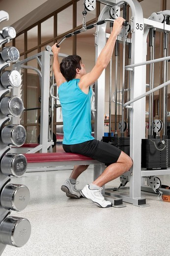 Stock Photo: 4105-1835 Man exercising in a gym