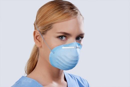 Stock Photo: 4105-1934 Female nurse wearing a flu mask