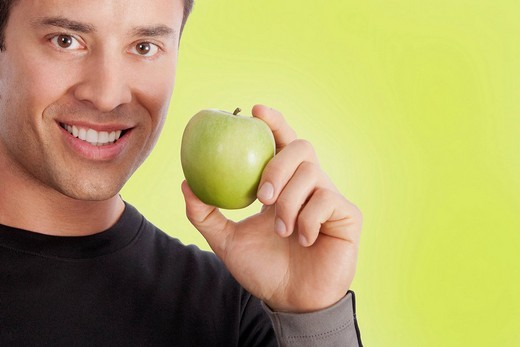 Man holding a green apple : Stock Photo