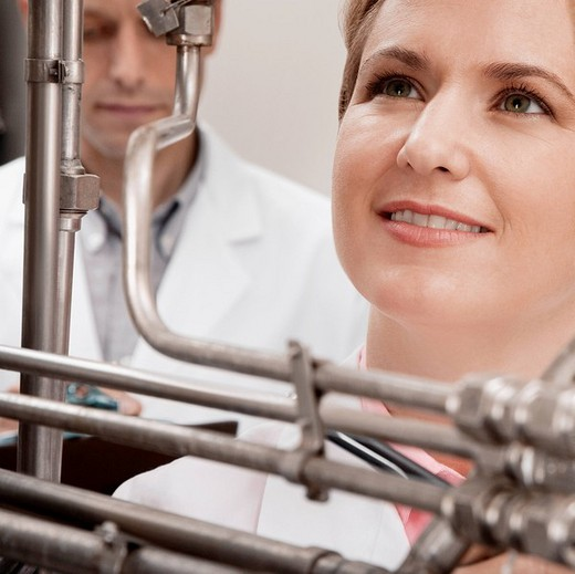 Doctors researching in a laboratory : Stock Photo