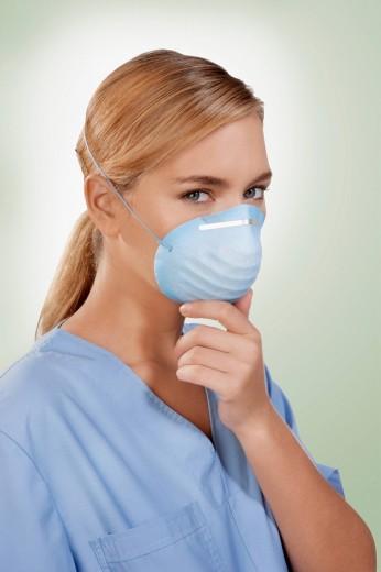 Stock Photo: 4105-2176 Female nurse wearing a flu mask