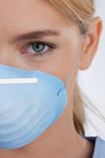 Female doctor wearing a flu mask : Stock Photo