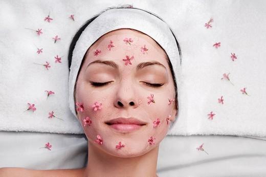 Stock Photo: 4105-2465 Woman receiving facial treatment