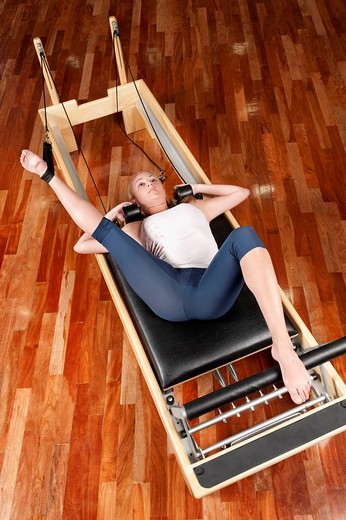 Woman exercising in a gym : Stock Photo