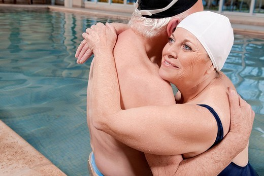 Couple embracing in a swimming pool : Stock Photo