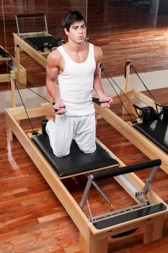Stock Photo: 4105-3417 Man exercising in a gym