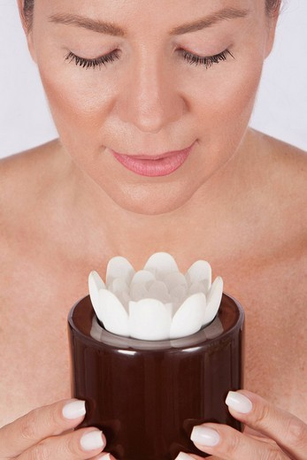 Close_up of a woman holding a candle : Stock Photo