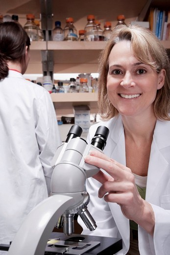 Stock Photo: 4105-3716 Female doctors working in a laboratory