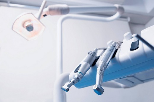 Close_up of dental instruments in an examination room : Stock Photo