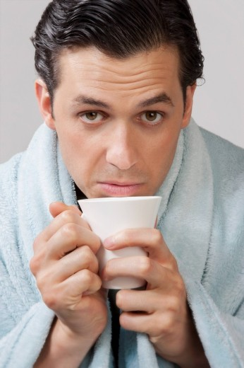 Stock Photo: 4105-4121 Portrait of a man taking hot drink