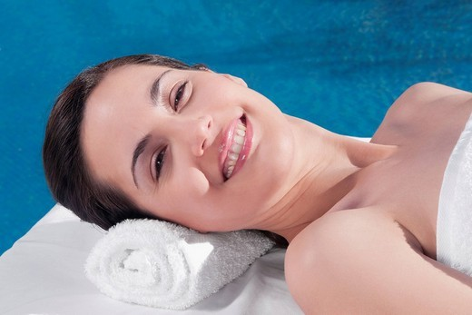 Woman lying on a massage table : Stock Photo