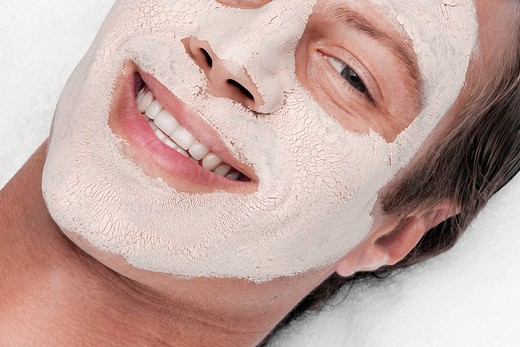 Man with face pack on his face : Stock Photo