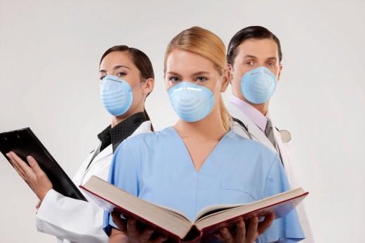 Portrait of doctors wearing flu masks : Stock Photo