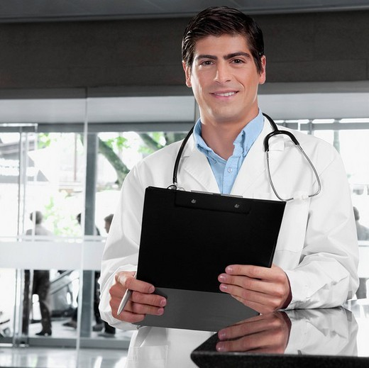 Stock Photo: 4105-4846 Portrait of a doctor holding a clipboard
