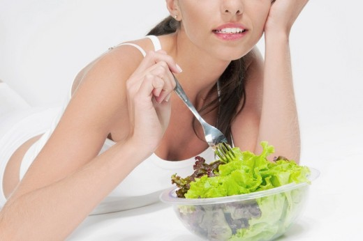 Stock Photo: 4105-4879 Close_up of woman eating salad