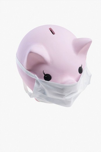 Stock Photo: 4105-4919 Close_up of a piggy bank wearing flu mask