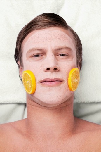 Orange slices on a man´s face : Stock Photo