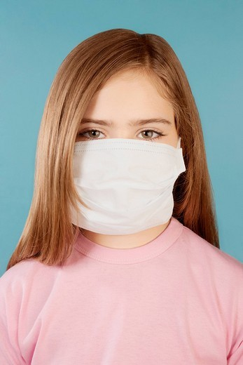Portrait of a girl wearing a flu mask : Stock Photo