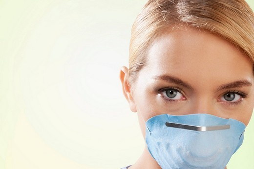 Female nurse wearing a flu mask : Stock Photo