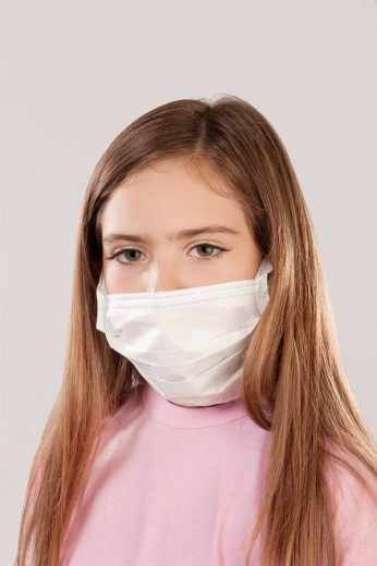 Stock Photo: 4105-5647 Portrait of a girl wearing a flu mask