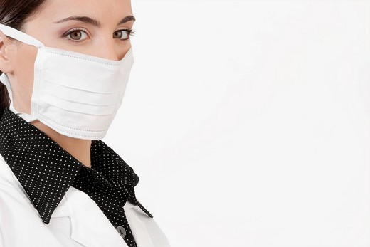 Female doctor wearing a flu mask : Stock Photo