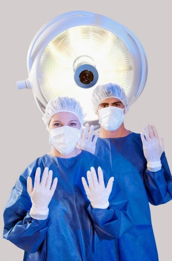 Two surgeons in an operating room : Stock Photo