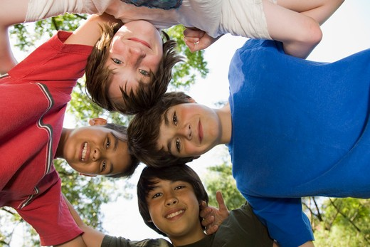Stock Photo: 4106-126 Low angle view of boys in a huddle