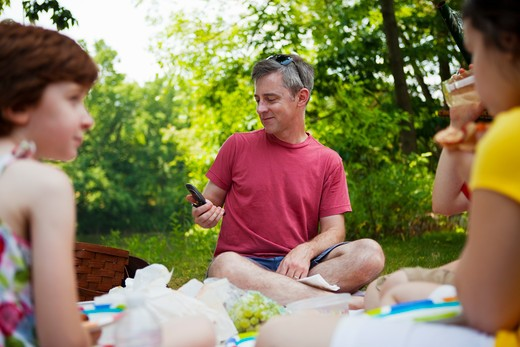 Family with two daughters having picnic : Stock Photo