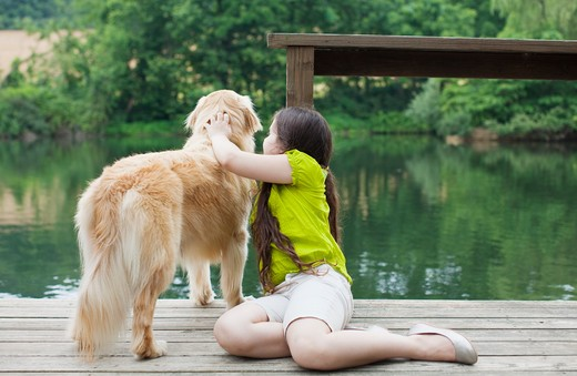 Stock Photo: 4106R-263B Girl with Golden Retriever on jetty
