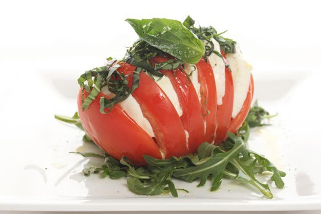 Stock Photo: 4109R-132 Tomato stuffed with mozzarella slices