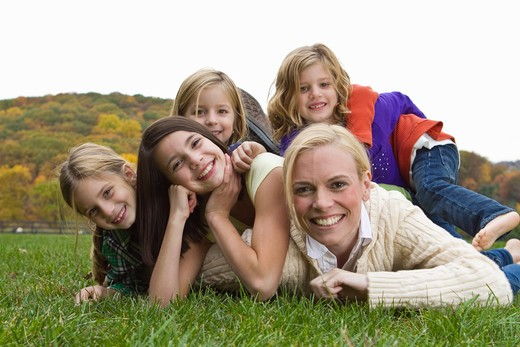 Stock Photo: 4113-206 Portrait of mother with four daughters lying on grass