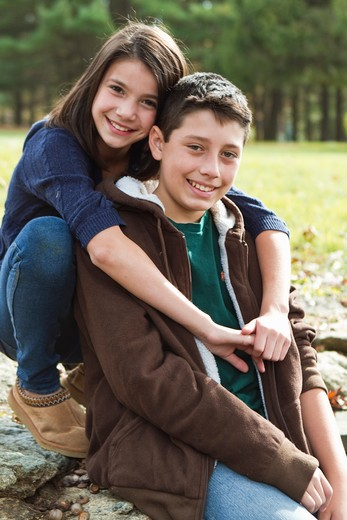 Portrait of brother and sister outdoors : Stock Photo