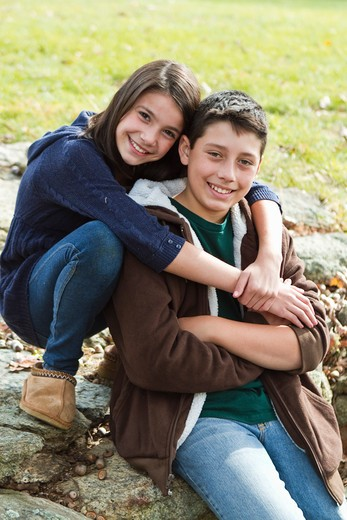 Stock Photo: 4113R-169 Portrait of brother and sister outdoors