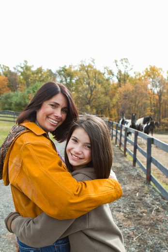 Stock Photo: 4113R-173 Portrait of mother and daughter on field