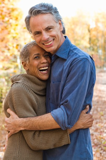 Portrait of mature couple standing on Autumn forest track : Stock Photo