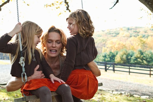 Stock Photo: 4113R-190J Mother with two daughters on swing