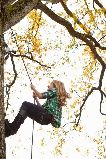 Stock Photo: 4113R-195B Girl climbing up tree