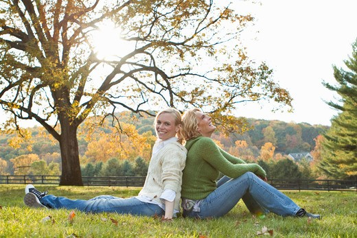 Stock Photo: 4113R-198A Two women sitting on field