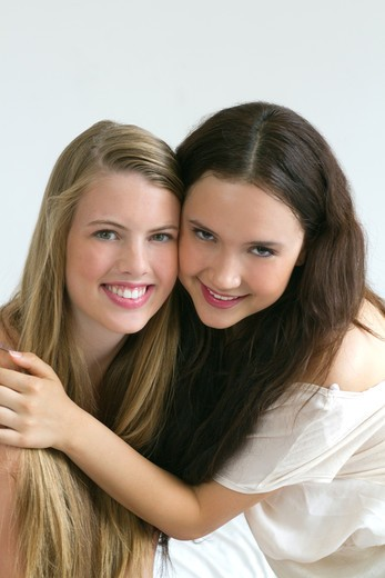 Stock Photo: 4113R-256 Portrait of two young women embracing