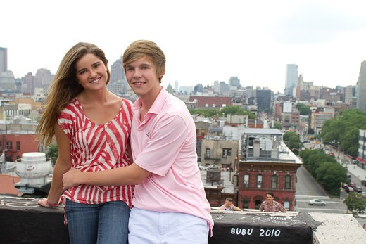 Stock Photo: 4113R-274 USA, New York City, Manhattan, Portrait of Teenage couple embracing on rooftop