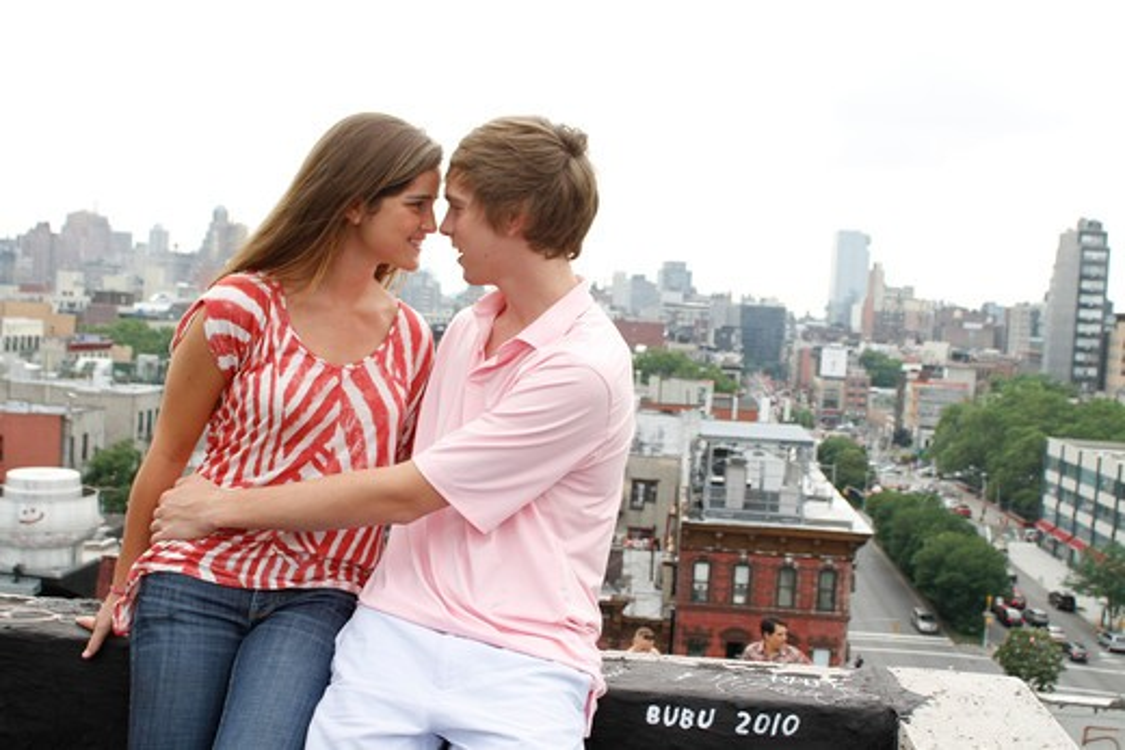 Stock Photo: 4113R-277 USA, New York, Manhattan, Teenage couple embracing on rooftop