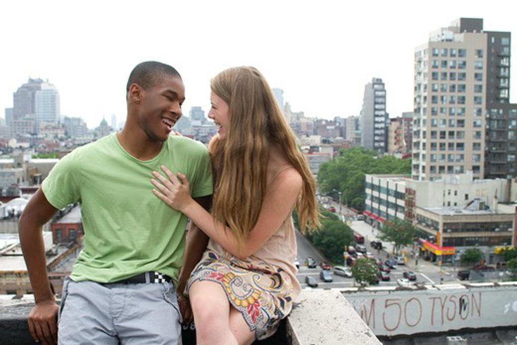 Stock Photo: 4113R-278 USA, New York, Manhattan, Teenage couple embracing on rooftop