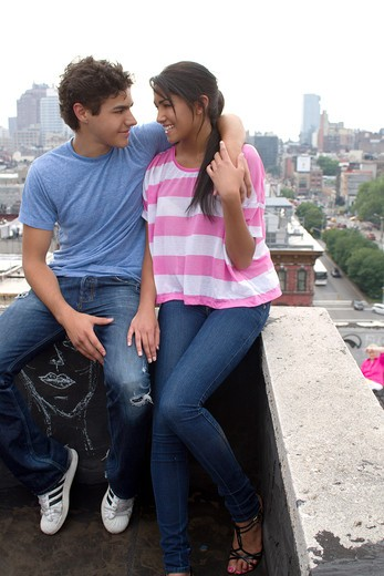 USA, New York, Manhattan, Teenage couple embracing on rooftop : Stock Photo