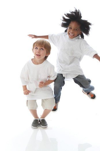 Studio shot of boys jumping and laughing : Stock Photo